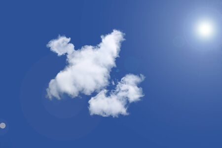 Abstract clouds in the form of a bird in the blue sky Stock Photo