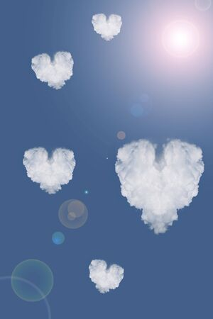 Clouds in the form of heart in the blue sky photo
