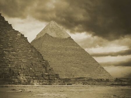 Pyramids of Gizeh near Cairo in Egypt on a cloudy day Stock Photo