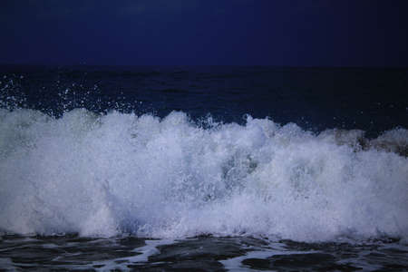 Wave and splashes at night. Sea landscape. Cyprus Stock Photo