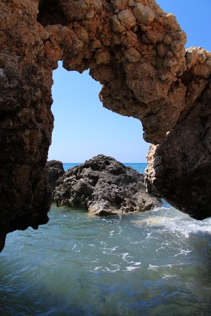tou: Grotto near Petra tou Romiou in Paphos, Cyprus (or Rock of Aphrodite,  Birhtplace of Aphrodite).