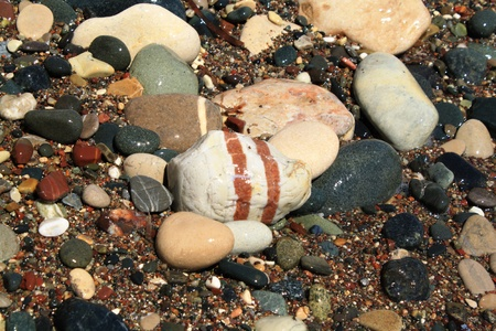 Color pebbles in sand Stock Photo - 10747483