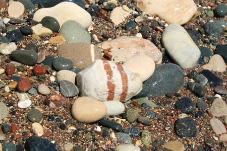 Color pebbles in sand Stock Photo