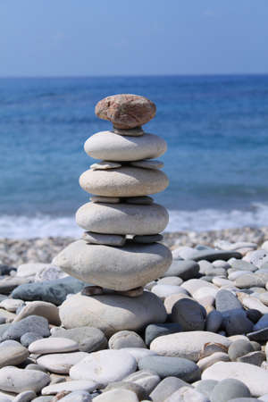 Figure from stones on a beach. Cyprus Stock Photo - 10880646