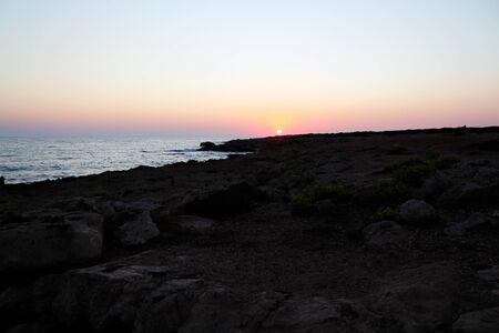 Sunset at coastline of Cyprus Stock Photo