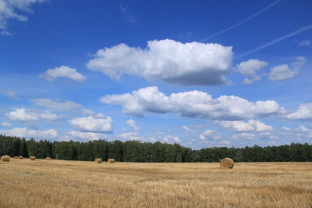 Autumn landscape: a haystack, the sky, clouds Stock Photo