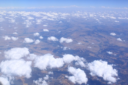 Flight by the plane. Cumulus clouds