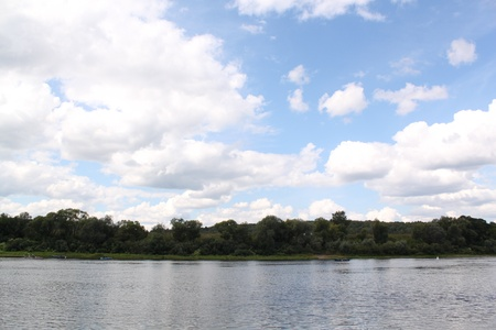Cumulus clouds over the river Stock Photo