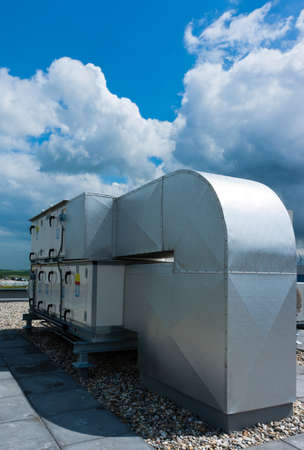 airco units mounted on a roof of an office building Stock Photo