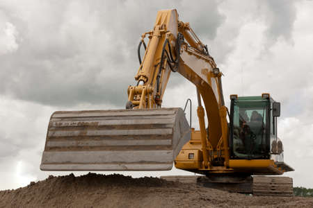 Excavator digging a trench