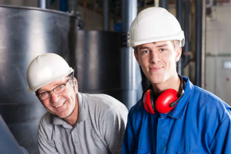 happy engineers with safety helmet, earplug and glasses