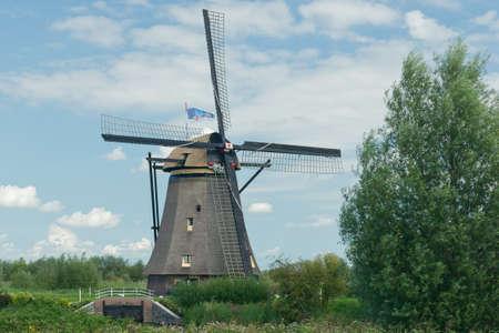A windmill near Kinderdijk in the Netherlands. photo