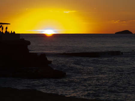 Sunset seen from the SW of Ibiza with a beachclub in the foreground Stock Photo