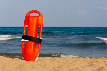 red buoy for a lifeguard to save people from drowning Stock Photo