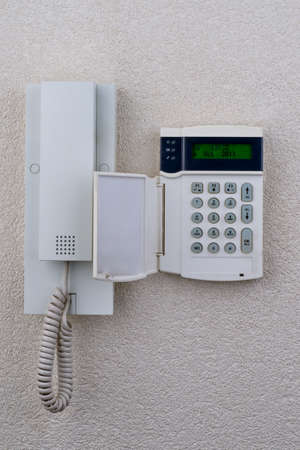 burgler: touchpanel to activate the alarm located besides the intercom