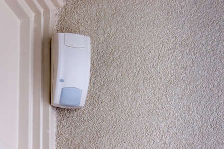pasive infrared  sensor mounted in the corner of a room