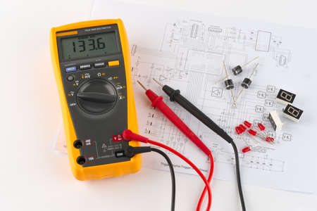 ohm: a true rms multimeter and a circuit diagram Stock Photo