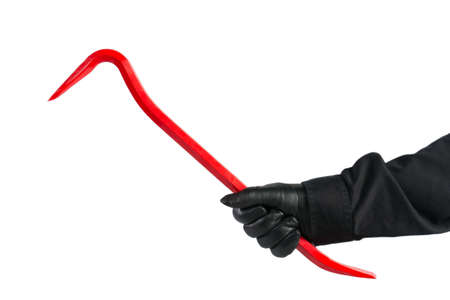 burglary: the arm of a thief with a crowbar in the hand (isolated) Stock Photo