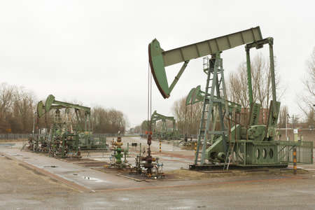 horsehead pump: Pumpjack or horsehead pumping up  crude oil from an oil well Stock Photo