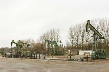 jack pump: Pumpjack or horsehead pumping up  crude oil from an oil well Stock Photo
