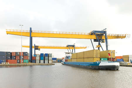 containers for local transport on a small ship Standard-Bild