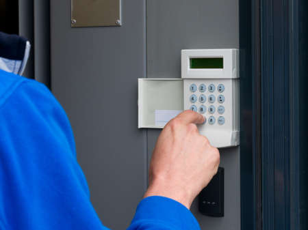 alarm system: touchpanel to activate the electronic alarm system Stock Photo