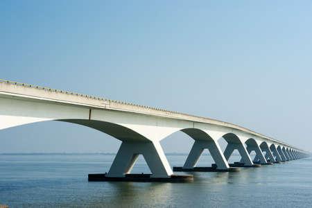 A Bridge crossing a wide river