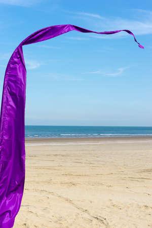 A purple banner on a sunny beach