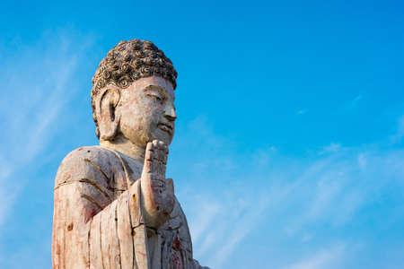 Buddha against a blue sky