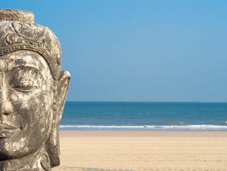 Buddha against a blue sky photo