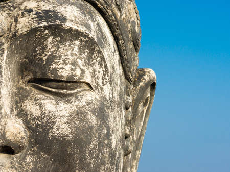 Buddha against a blue sky photo