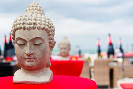 Buddha statues on the beach photo