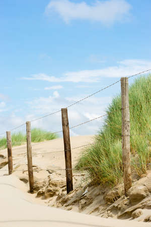 barbed wire fences: dunes behind barbed wire fences
