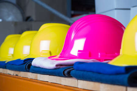 blue helmet: shelf with a  row of clean clothing for the working class