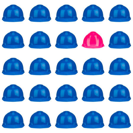 pink helmet surrounded by various blue hardhats Stock Photo - 16586687