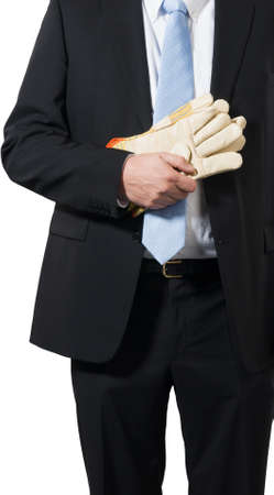 businessman ready to put on some gloves to do the dirty work Stock Photo - 16692996