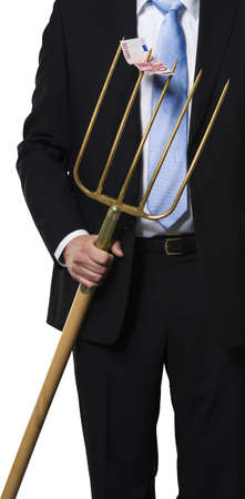 Executive showing a fork with a euro bill on it as a metaphor for raking the money together Stock Photo - 16928143