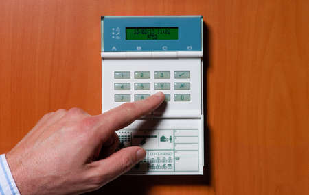 activate: touchpanel to activate the electronic alarm system Stock Photo