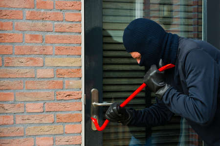 protect home: Burglar carrying the tool of choice