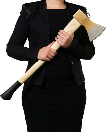 businesswoman ready to put an axe to work and chop to make the business healthy photo