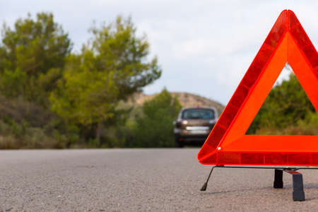 warning triangle: Vehicle with problems and a warning triangle