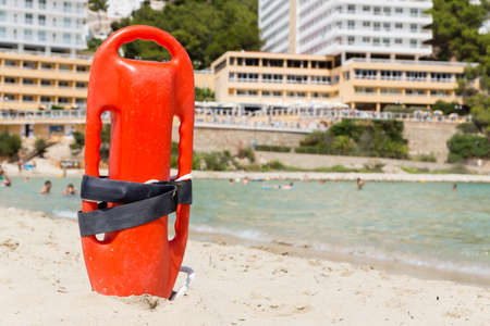 beach buoy: a red buoy on a sunny beach Stock Photo