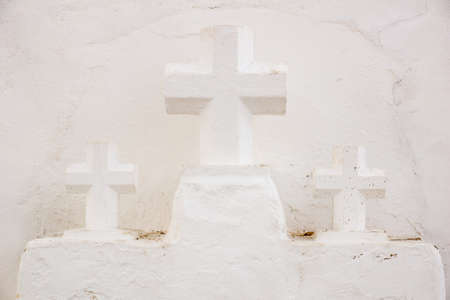 crucifixes: Three Crucifixes besides the Church of Sancta Eularia Ibiza Spain