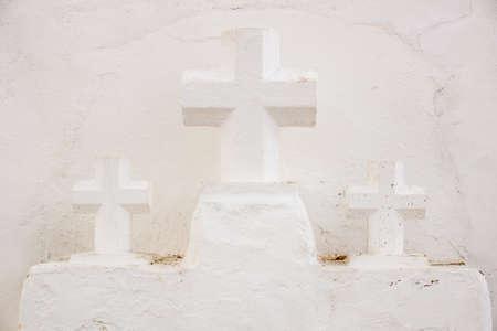 crucifixes: Three Crucifixes besides the Church of Sancta Eularia Ibiza Spain
