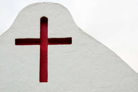 A red cross above a cemetary in Sancta Eularia Ibiza Spain Stock Photo
