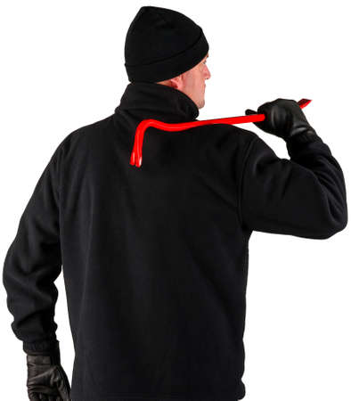 thievery: caucasian burglar with a crowbar in his hand