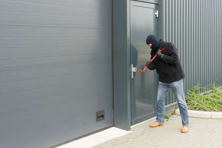burglar: burglar in disguise to open an industrial door with brute force