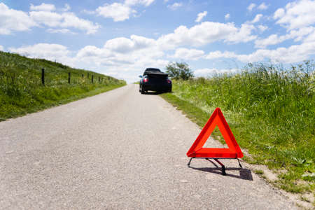 Cabrio with a engine breakdown in a rural scene