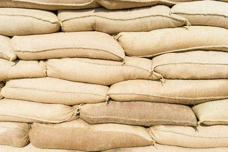 sandbag: sandbags stacked to form a wall