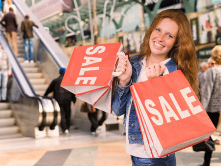 Young woman is happy to shop during the sales